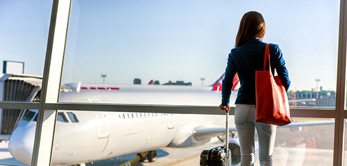 Woman looking at plane